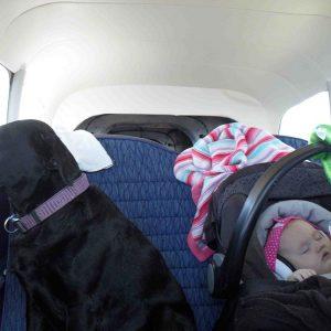 ems-4-bubs-earmuffs-chloe-sleeping-in-a-small-plane