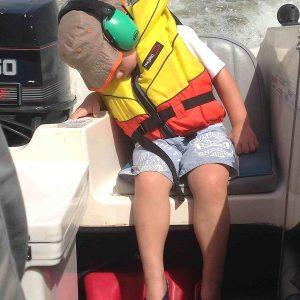 ems-4-kids-earmuffs-sleeping-next-to-an-outboard-motor_0