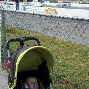 sleeping-trackside-at-the-drag-racing-ems-4-kids-silver-earmuffs-doing-the-job-well